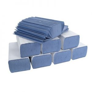 7 wrapped blue hand towels with one open packet on top
